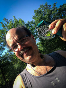 Carlos Candelaria and Umstead Half Medal