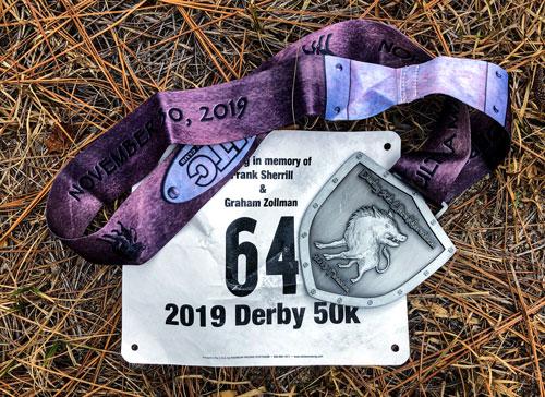Derby 50k 2019 bib and medal