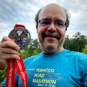 2021 Tobacco Road Half Marathon Carlos Candelaria and medal